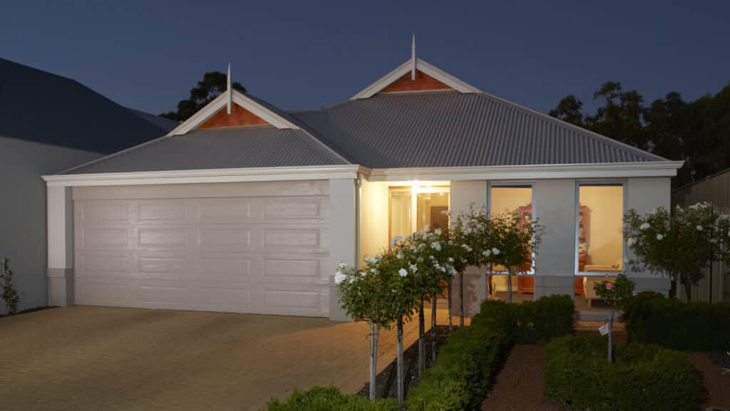 Small home with a nice garage door at dusk