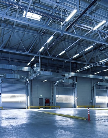 Large commercial warehouse with many garage doors
